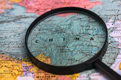 Map of china through magnifying glass on a world map. Map of china through magnifying glass on a world map Stock Photo