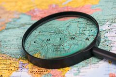 Map of china through magnifying glass on a world map. Map of china through magnifying glass on a world map Royalty Free Stock Photo