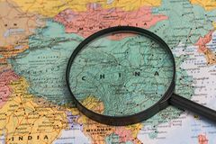 Map of china through magnifying glass on a world map. Map of china through magnifying glass on a world map Stock Photography