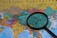 Map of china through magnifying glass on a world map. Map of china through magnifying glass on a world map Stock Images