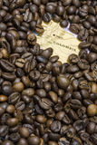 Map of Colombia under a background of coffee beans Stock Images