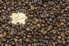 Map of Colombia under a background of coffee beans Royalty Free Stock Photo