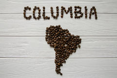 Map of the Columbia made of roasted coffee beans laying on white wooden textured background. Space for text Stock Photo