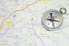 Map and compass. With a light color set Royalty Free Stock Photo