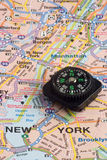 Map and compass. Map of New York City and compass Royalty Free Stock Photography
