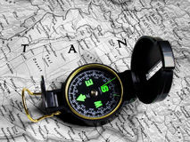 Map and compass 2. A compass on top of a map royalty free stock images