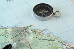Map and Compass. Picture of a map, with compass and magnifying glass Royalty Free Stock Photography