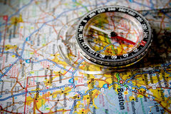 Map with Compass. Close-up picture of a compass sitting on a map of Boston with the needle on North Stock Photography