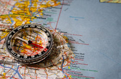 Map with Compass. Close-up picture of a compass sitting on a map of Boston with the needle on North Stock Image