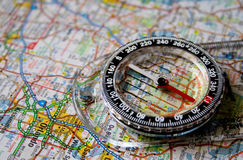 Map with Compass. Close-up picture of a compass sitting on a map of Orlando with the needle on North Stock Image