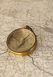 Map and compass .. Vertical image of an old compass on a map Stock Photos