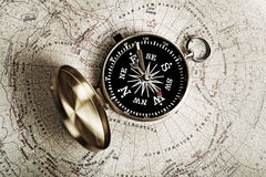 Map and compass. Map is a drawing or plan of the surface of the earth that shows countries, mountains, roads, etc Royalty Free Stock Photography