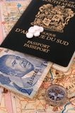 Map, compass, African money, passport and Tablets Stock Photos