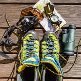 Map, compass, camera, monocular, glasses and hiking shoes for tr. Aveling, gears, tools Royalty Free Stock Photos