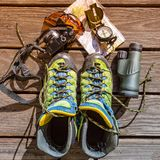 Map, compass, camera, monocular, glasses and hiking shoes for tr. Aveling, gears, tools Stock Photography