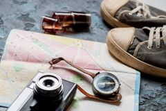 Map, compass, camera and sneakers stock photos