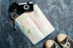 Map, compass, camera and sneakers stock photography