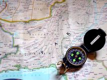 Map and compass - colour. A compass on top of a map royalty free stock photos