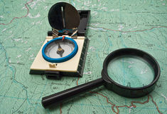 Map, compass and magnifying glass Stock Photo