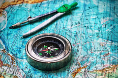 Map and compass. Compass on old nautical map vintage style.Applied texture Stock Photo