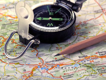 Map, compass and pencil. Compass, map and pencil. Close-up, colored. Germany routes. Orange-green Royalty Free Stock Photos