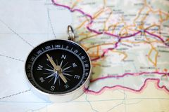 Map with compass. Simple navigation tools to orient in the world. Education Stock Photography