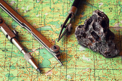Map and compasses. Travel planning. Royalty Free Stock Images