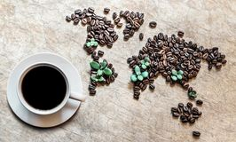 Map of continents from coffee beans on a wooden background. Map of continents from coffee beans on an old wooden background royalty free stock photography