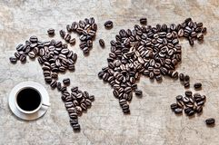 Map of continents from coffee beans on a wooden background. Map of continents from coffee beans on an old wooden background stock photography