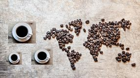 Map of continents from coffee beans on a wooden background. Map of continents from coffee beans on an old wooden background stock photos