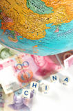 Map and currencies. Stock Photos