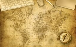 Map desk with office accessories stock photography