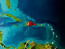 Map of Dominican Republic on Earth. Dominican Republic in the morning highlighted in red on planet Earth with visible border lines and city lights. 3D Royalty Free Stock Images