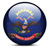 Map with Dot Pattern on flag button of USA North Dakota State Stock Image
