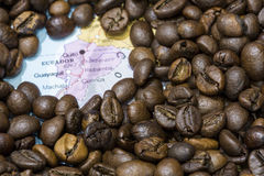 Map of Ecuador under a background of coffee beans Stock Image