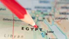 Map of Egypt hot spot. Political conflict or hot spot concept with red pencil pointing at the map of Egypt Stock Images