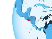 Map of El Salvador. 3D render of El Salvador in red on blue political globe with transparent oceans. 3D illustration royalty free illustration