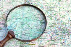 Map of England and vintage magnifying glass. Background with space for text or image royalty free stock photo