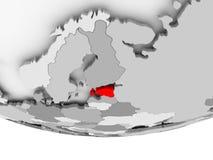 Map of Estonia on grey political globe. Estonia in red on grey political globe. 3D illustration Stock Photography