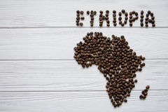 Map of the Ethiopia made of roasted coffee beans laying on white wooden textured background. And space for text Royalty Free Stock Images