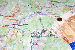 Map and Euros. Map of some trails in the Austrian alps and some euro money Stock Photos