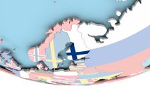 Map of Finland with flag on globe. Finland on globe with flag. 3D illustration Stock Photos