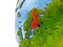 Map of Finland on model of globe. Finland in red on globe with real land surface, visible country borders and water in place of ocean. 3D illustration. Elements Stock Images