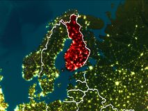 Map of Finland at night. Finland highlighted in red from Earth's orbit at night with visible country borders. 3D illustration. Elements of this image furnished Royalty Free Stock Photography