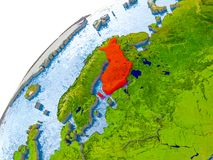 Map of Finland in red on globe. Finland on simple globe with visible country borders and realistic water in the oceans. 3D illustration. Elements of this image Royalty Free Stock Photos