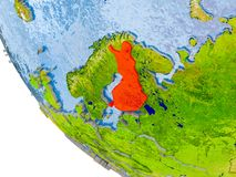 Finland on globe. Map of Finland in red on globe with real planet surface, embossed countries with visible country borders and water in the oceans. 3D Royalty Free Stock Images