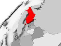 Finland on grey political globe. Map of Finland in red on grey political globe. 3D illustration Royalty Free Stock Image
