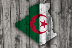 Map and flag of Algeria on weathered wood Stock Images