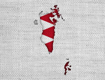 Map and flag of Bahrain on old linen Stock Photography