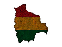 Map and flag of Bolivia on rusty metal Royalty Free Stock Images
